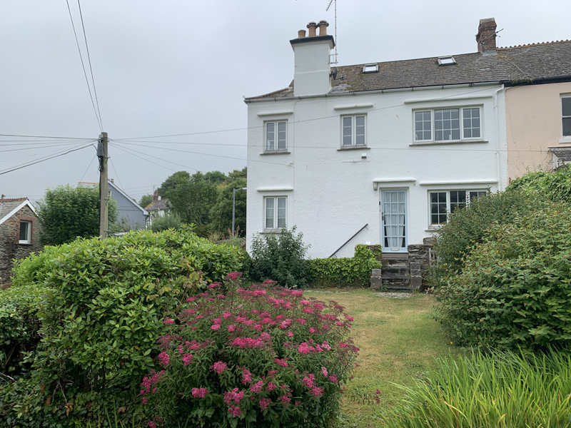 view of corner cottage from the garden
